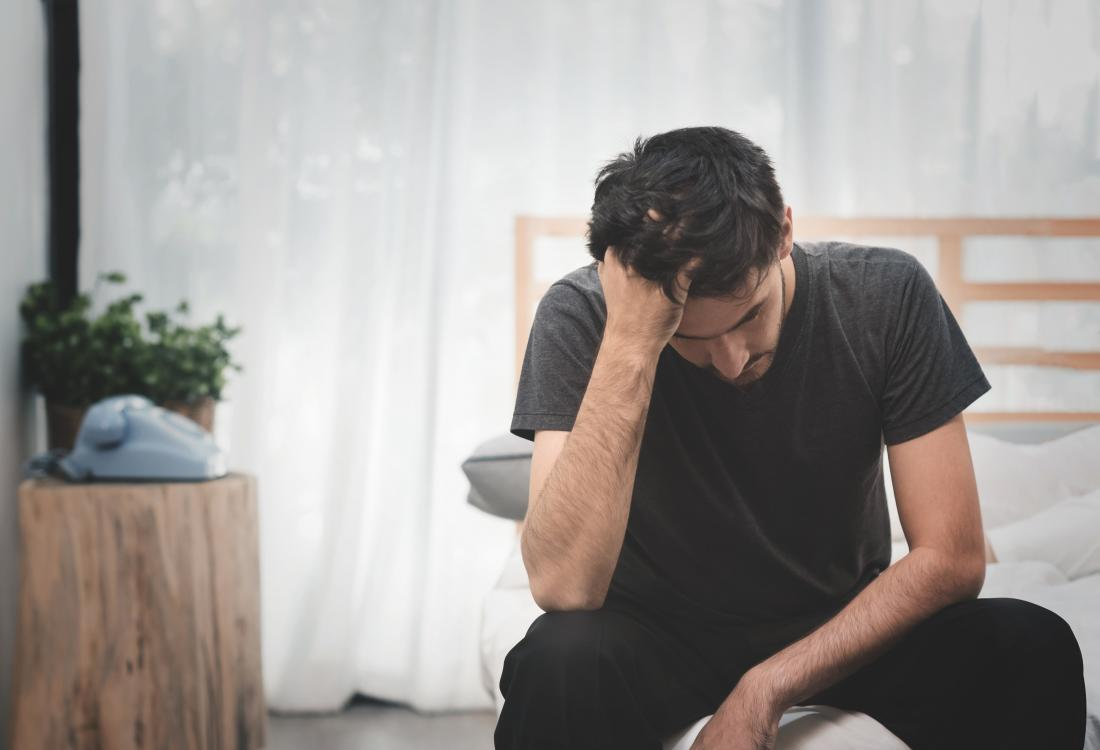 man sat on the end of his bed worried about masturbation causing erectile dysfunction