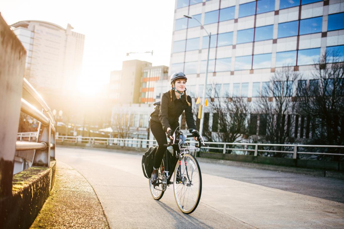 women cycling to work