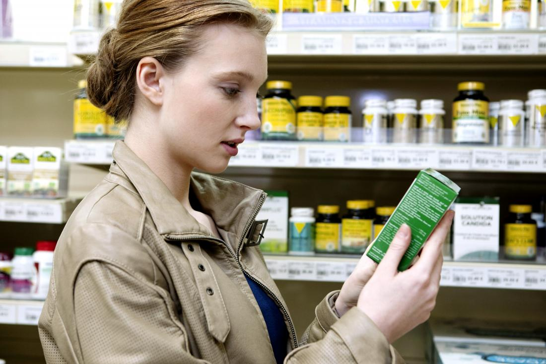 young woman looking at complementary medicine